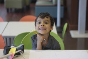 Young boy smiling at camera