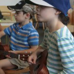 Two children playing guitar
